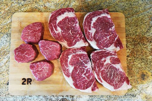 4 ribeyes 4 tenders on cutting board.jpg